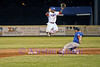 Trying to reach an overthrown ball, 2nd baseman Antoin Gray leaps to try to catch it.