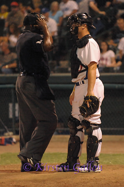 Scott Dalrymple chatting up the homeplate umpire.