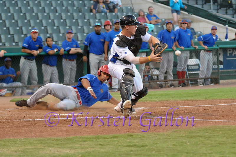 Scott Dalrymple going after throw from the outfield for a possible tag out.  Unfortunately the throw wasn't in time.