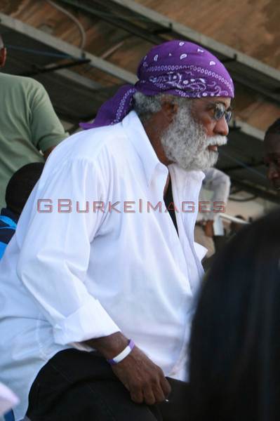 Jamaica's reggae icon Merritone enjoying the events all decked out in Kingston College's purple and white!
