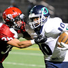 "Fairview's Aaron MacArthur tackles Eddric Turner during a football game against Overland High School on Friday, Sept. 7, at Recht Field in Boulder. For more photos of the game go to  <a href=""http://www.dailycamera.com"">http://www.dailycamera.com</a><br /> Jeremy Papasso/ Camera"