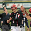 "Neil Vlier of Fairview celebrates a home run with teammates against Air Academy.<br /> For more photos of the game, go to  <a href=""http://www.dailycamera.com"">http://www.dailycamera.com</a>.<br /> Cliff Grassmick/ March 30, 2011"