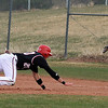 "Brian Sture of Fairview gets back safely to first because the ball gets past  Jeremy Hochmuth of Air Academy.<br /> For more photos of the game, go to  <a href=""http://www.dailycamera.com"">http://www.dailycamera.com</a>.<br /> Cliff Grassmick/ March 30, 2011"