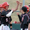 "Evan Thoning (5) of Fairview, celebrates his 2-run home run in the first inning against Air Academy.<br /> For more photos of the game, go to  <a href=""http://www.dailycamera.com"">http://www.dailycamera.com</a>.<br /> Cliff Grassmick/ March 30, 2011"