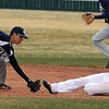 "Jovian Santiago of Air Academy tags out Brian Sture of Fairview at second.<br /> For more photos of the game, go to  <a href=""http://www.dailycamera.com"">http://www.dailycamera.com</a>.<br /> Cliff Grassmick/ March 30, 2011"