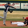 "Jovian Santiago, left, of Air Academy, tries to turn a double play with Jack Madden of Fairview sliding into second.<br /> For more photos of the game, go to  <a href=""http://www.dailycamera.com"">http://www.dailycamera.com</a>.<br /> Cliff Grassmick/ March 30, 2011"