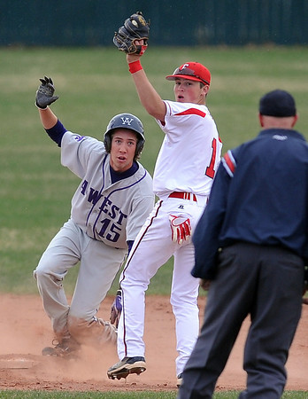 "Cam Frazier of Fairview is late on the tag of  Kevin Mitchell of Arvada West. Mitchell was called safe.<br /> For more photos of the game, go to  <a href=""http://www.dailycamera.com"">http://www.dailycamera.com</a>.<br /> Cliff Grassmick/ April 6, 2011"