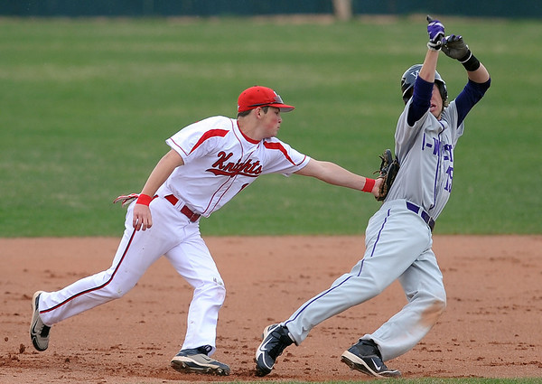 "Cam Frazier of Fairview  tags out  Kevin Mitchell of Arvada West between second and third.<br /> For more photos of the game, go to  <a href=""http://www.dailycamera.com"">http://www.dailycamera.com</a>.<br /> Cliff Grassmick/ April 6, 2011"