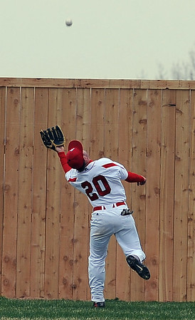 "Brian Sture of Fairview makes this catch against Arvada West on Wednesday.<br /> For more photos of the game, go to  <a href=""http://www.dailycamera.com"">http://www.dailycamera.com</a>.<br /> Cliff Grassmick/ April 6, 2011"