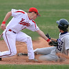 "Cam Frazier of Fairview is late on the tag of  Kevin Mitchell of Arvada West.<br /> For more photos of the game, go to  <a href=""http://www.dailycamera.com"">http://www.dailycamera.com</a>.<br /> Cliff Grassmick/ April 6, 2011"