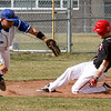 Fairview'sJordan Blair, 23, slides into third base as Plattsmouth Andrew Han, 25, runs for the ball, Saturday, March. 17, 2012, Boulder. <br /> Derek Broussard/ Camera
