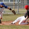 Fairview'sJordan Blair, 23, slides into third base as Plattsmouth Andrew Han, 25, runs for the ball, Saturday, March. 17, 2012, Boulder. <br /> Derek Broussard/ Camera
