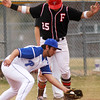 Fairview's Rocky DeSantis, 25, stops on third base as Plattsmouth Dylan Knople, 4, catches the ball, Saturday, March. 17, 2012, Boulder. <br /> Derek Broussard/ Camera