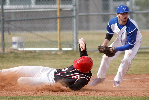 Fairview's Anderas Hill, 9, slides into third base as Plattsmouth Dylan Sutton, 26, throws the ball to second base, Saturday, March. 17, 2012, Boulder. <br /> Derek Broussard/ Camera