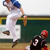 Fairview's Cameron Frazier, 3, slided into second base as Travis Maddax,12, jumps for the ball in the third inning verses Plattsmouth, Saturday, March. 17, 2012, Lafayette. <br /> Derek Broussard/ Camera