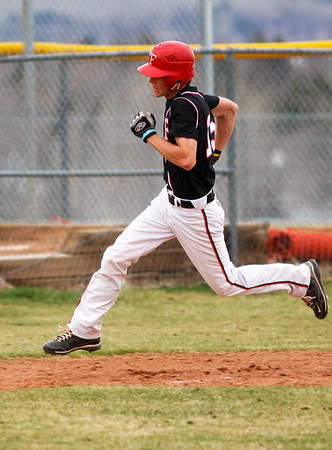 Fairview's Kyle Herndan,15, runs for home during the third inning of the game verses Plattsmouth, Saturday, March. 17, 2012, Boulder. <br /> Derek Broussard/ Camera