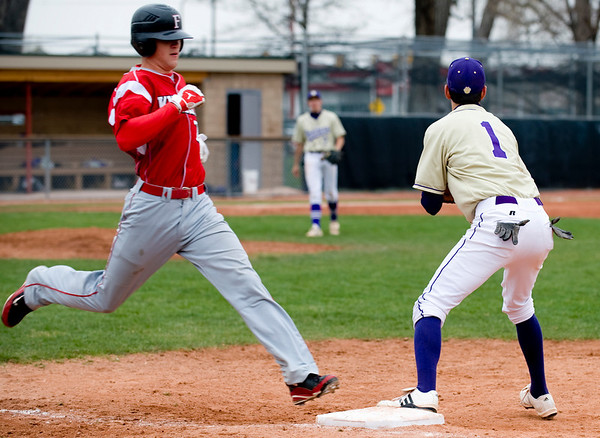 Boulder's Drew Noolas (right) gets out Fairview's Neil Vlier during the game at Scott Carpenter Park in Boulder, Saturday, APril 17, 2010.