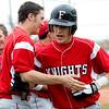 Fairview's Travis Scavo is congratulated after hitting a home run during the game against Boulder at Scott Carpenter Park in Boulder, Saturday, APril 17, 2010.