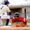 Boulder's Drew Noolas (left) waits for the back ball as Fairview's Roby Gordon slides back to first during the game at Scott Carpenter Park in Boulder, Saturday, APril 17, 2010.