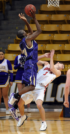 Johnoy Albert of Boulder High goes up strong on Darragh O'Neill of Fairview.<br /> <br /> Cliff Grassmick / January 22, 2010