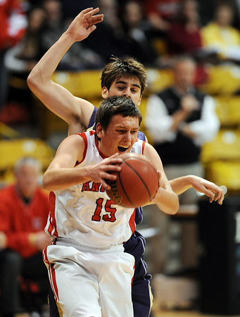 Shane O'Neill of Fairview gets a rebound in front of Ethan Baker of Boulder.<br /> <br /> Cliff Grassmick / January 22, 2010