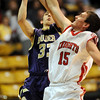 Shane O'Neill of Fairview, blocks the shot of Andre Rieder of Boulder on Friday.<br /> <br /> Cliff Grassmick / January 22, 2010
