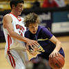 Riley Grabau of Boulder High tries to get around Michael Melillo of Fairview on Friday.<br /> <br /> Cliff Grassmick / January 22, 2010