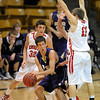 Drew Noolas of Boulder High gets trapped by  Ryan Gallup, among others from Fairview.<br /> <br /> Cliff Grassmick / January 22, 2010