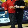 Fairview boys coach Frank Lee, left, and Boulder coach Alan Schulz, share a moment after the Boulder-Fairview basketball game on Friday.<br /> <br /> Cliff Grassmick / January 22, 2010