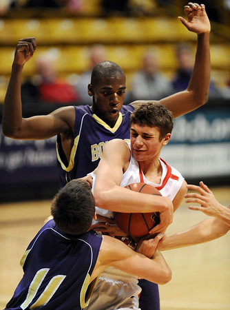 Michael Melillo of Fairview gets a rebound in front of Johnoy Albert of Boulder.<br /> <br /> <br /> Cliff Grassmick / January 22, 2010