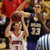"Darragh O'Neill of Fairview goes up against Andre Rieder of Boulder on Friday. For more photos of the game, go to  <a href=""http://www.dailycamera.com"">http://www.dailycamera.com</a>.<br /> Cliff Grassmick / January 22, 2010"