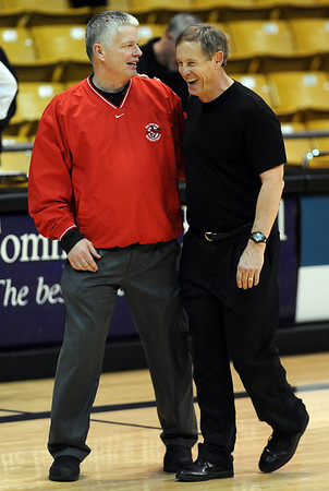 Fairview boys coach Frank Lee, left, and Boulder coach Alan Schulz, share a moment after the Boulder-Fairview basketball game on Friday.<br /> Cliff Grassmick / January 22, 2010