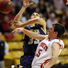 Shane O'Neill of Fairview, blocks the shot of Andre Rieder of Boulder on Friday.<br /> Cliff Grassmick / January 22, 2010