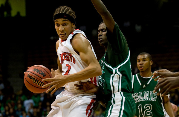 Fairview's Kenny Bell (left) looks around for an opening while Aurora Central's Rachaud Russell during the semifinals of the boys 5A State Championships at the Coors Event Center on the University of Colorado campus in Boulder, Thursday, March 11, 2010. <br /> <br /> KASIA BROUSSALIAN