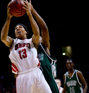 Fairview's Kenny Bell (front) shoots while Aurora Central's Carlton Hurst defends during the semifinals of the boys 5A State Championships at the Coors Event Center on the University of Colorado campus in Boulder, Thursday, March 11, 2010.   KASIA BROUSSALIAN