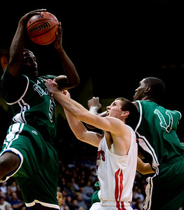 Fairview's Darragh O'Neill goes up for a rebound with Aurora Central's Shawn Banks (left) and DeSe Lee during the semifinals of the boys 5A State Championships at the Coors Event Center on the University of Colorado campus in Boulder, Thursday, March 11, 2010.   KASIA BROUSSALIAN