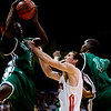 Fairview's Darragh O'Neill goes up for a rebound with Aurora Central's Shawn Banks (left) and DeSe Lee during the semifinals of the boys 5A State Championships at the Coors Event Center on the University of Colorado campus in Boulder, Thursday, March 11, 2010. <br /> <br /> KASIA BROUSSALIAN
