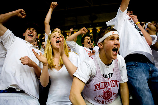(From left to right) Fairview seniors  Hayden Moore, Emily Narum, Eric Davids, and Dave Warren cheer for their boys basketball team during the semifinals of the boys 5A State Championships at the Coors Event Center on the University of Colorado campus in Boulder, Thursday, March 11, 2010. <br /> <br /> KASIA BROUSSALIAN