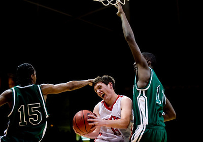 Fairview's Shane O'Neill (center) is fouled by Aurora Central's Carlton Hurst (left) during the semifinals of the boys 5A State Championships at the Coors Event Center on the University of Colorado campus in Boulder, Thursday, March 11, 2010.   KASIA BROUSSALIAN