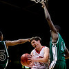 Fairview's Shane O'Neill (center) is fouled by Aurora Central's Carlton Hurst (left) during the semifinals of the boys 5A State Championships at the Coors Event Center on the University of Colorado campus in Boulder, Thursday, March 11, 2010. <br /> <br /> KASIA BROUSSALIAN