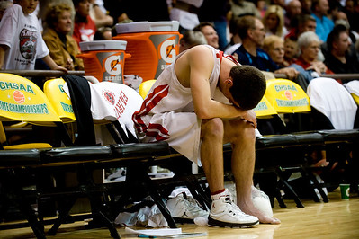 Fairview's Darragh O'Neill holds ice onto his injured ankle during the final minutes of the game against Aurora Central during the semifinals of the boys 5A State Championships at the Coors Event Center on the University of Colorado campus in Boulder, Thursday, March 11, 2010.   KASIA BROUSSALIAN