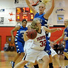 Sierra Bender of Fairview, tries to get around Bre Burgesser of Broomfield.<br /> Cliff Grassmick / December 12, 2009