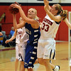 Bre Burgesser of Broomfield, goes up on Izzy Funke of Fairview on Saturday.<br /> Cliff Grassmick / December 12, 2009