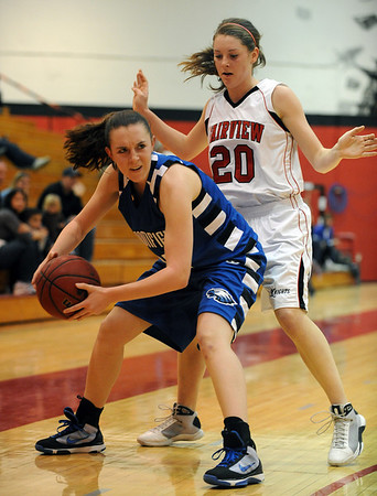 Sarah Hix, left, of Broomfield, looks to pass around Caitlin Higgins of Fairview on Saturday.<br /> Cliff Grassmick / December 12, 2009