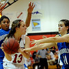 Nina Ball (13) of Fairview, gets doubled by Tyana Medema, left, and Kody Bradfield of Broomfield.<br /> Cliff Grassmick / December 12, 2009