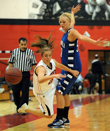 The ball gets away from Casey Thayer of Fairview while being defended by  Bre Burgesser of Broomfield.<br /> Cliff Grassmick / December 12, 2009