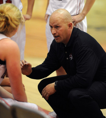 Fairview coach Rod Beauchamp   during a time out against Broomfield.<br /> Cliff Grassmick / December 12, 2009
