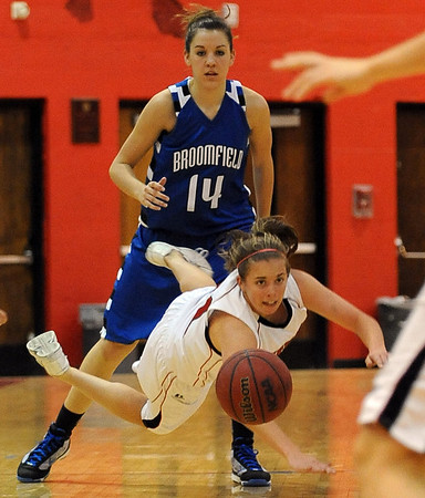 The ball gets away from Casey Thayer of Fairview while being defended by  Katie Nehf of Broomfield.<br /> Cliff Grassmick / December 12, 2009