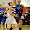 Nina Ball, left, of Fairview, drives pas Bre Burgesser of Broomfield on Saturday.<br /> Cliff Grassmick / December 12, 2009