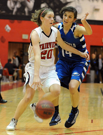 Caitlin Higgins of Fairview drives around Katie Nehf of Broomfield on Saturday.<br /> Cliff Grassmick / December 12, 2009